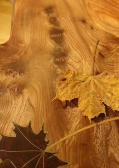 Maple leaf table with shelf - decorative detail